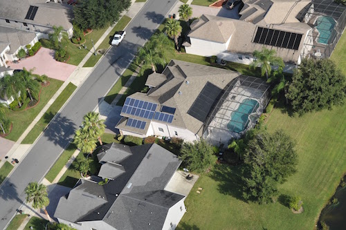 Aerial View of Solar Panels Installed on Homes