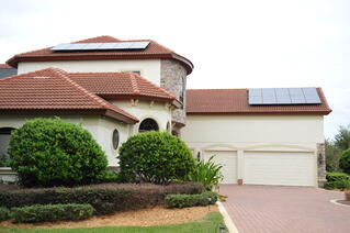 Residential Photovoltaic Solar Panels on two story home