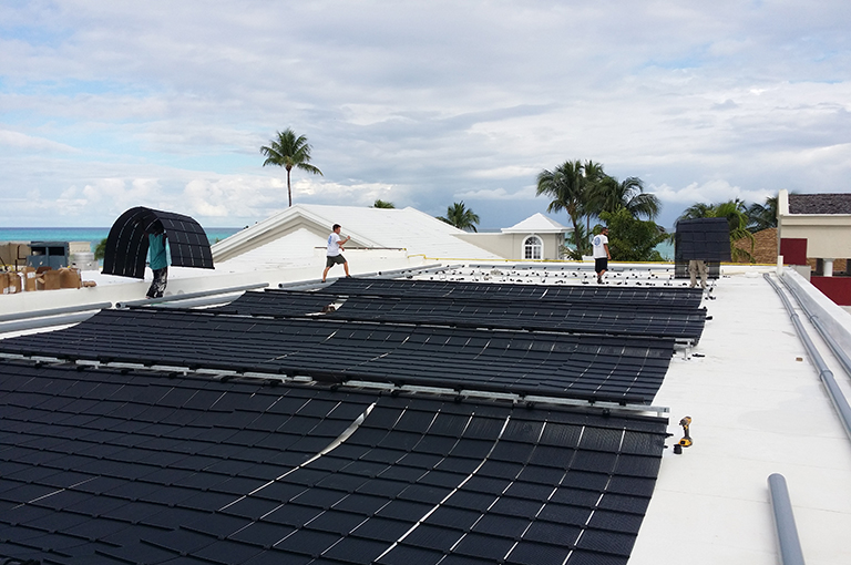 Heliocol-Solar-Pool-System-on-a-Shingle-Roof-3.jpg