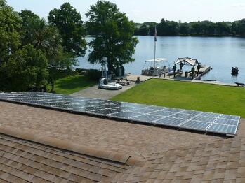 Solar panels on shingle roof near Hillsborough river